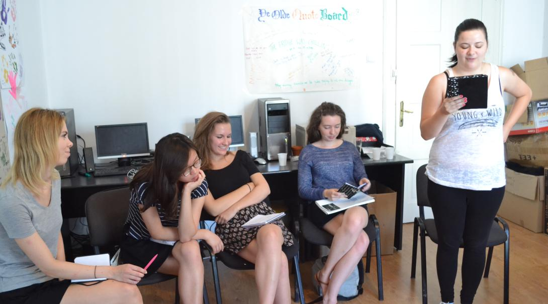 Journalism volunteers discuss their story ideas as part of their Journalism Project for teenagers